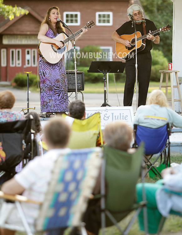 Pine Bush, New York - Singers Ken DeAngelis and Julie Ziavras perform for people outside on a summer evening on Aug. 13, 2010.