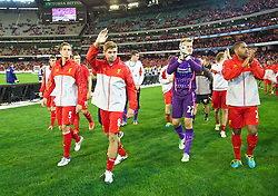 MELBOURNE, AUSTRALIA - Wednesday, July 24, 2013: Liverpool's Daniel Agger, captain Steven Gerrard, goalkeeper Simon Mignolet and Glen Johnson after their side's 2-0 victory over Melbourne Victory during a preseason friendly match at the Melbourne Cricket Ground. (Pic by David Rawcliffe/Propaganda)