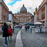 "ROME, ITALY - JUNE 03: Illustration of Rome; Italy on June 03, 2012.St. Peter's Square - Piazza San Pietro - Vatican. Via della Conciliazione..The open space which lies before the basilica was redesigned by Gian Lorenzo Bernini from 1656 to 1667, under the direction of Pope Alexander VII, as an appropriate forecourt, designed ""so that the greatest number of people could see the Pope give his blessing, either from the middle of the façade of the church or from a window in the Vatican Palace"".?Before the construction of the present basilica, the western part of the square was occupied by a large peristyle which gave access to the old building was built by Emperor Constantine.?In the origins, the square used to be the place where Nerone Circus and Gardens where located, and where many Christians, including Saint Peter, suffered from martyrdom.?In 1936 the architects M. Piacentini and A. Spaccarelli started the construction of via della Conciliazione in order to grant to the square a symmetric and monumental entrance; but this caused the destruction of the old Medieval village and of its typical narrow streets, a choice that aroused bitter controversy."