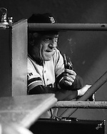Detroit Tigers manager Sparky Anderson smokes a pipe in the dugout.