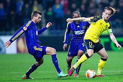 Ivan Rakitic of Sevilla and Zeljko Filipovic #5 of Maribor during football match between NK Maribor and Sevilla FC (ESP) in 1st Leg of Round of 32 of UEFA Europa League 2014 on February 20, 2014 at Stadium Ljudski vrt, Maribor, Slovenia. Photo by Matic Klansek Velej / Sportida
