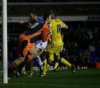Birmingham keeper Colin Doyle gathers safely under pressure from Leeds Matt Heath