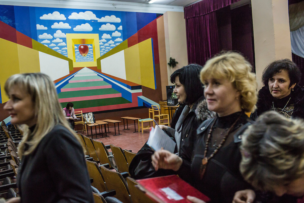 MARIUPOL, UKRAINE - FEBRUARY 5, 2015: Teachers at School 68 leave a training for how to respond in case of nearby fighting in Mariupol, Ukraine. With more than 220 people having died in the past several weeks, a new diplomatic push is underway to bring an end to fighting between pro-Russia rebels and Ukrainian forces. CREDIT: Brendan Hoffman for The New York Times