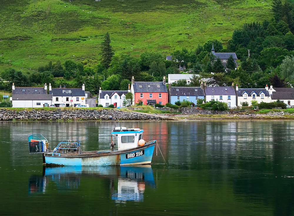 A picture postcard Scottish village with the varicoloured houses and a charming fishing boat make for a satisfying location.