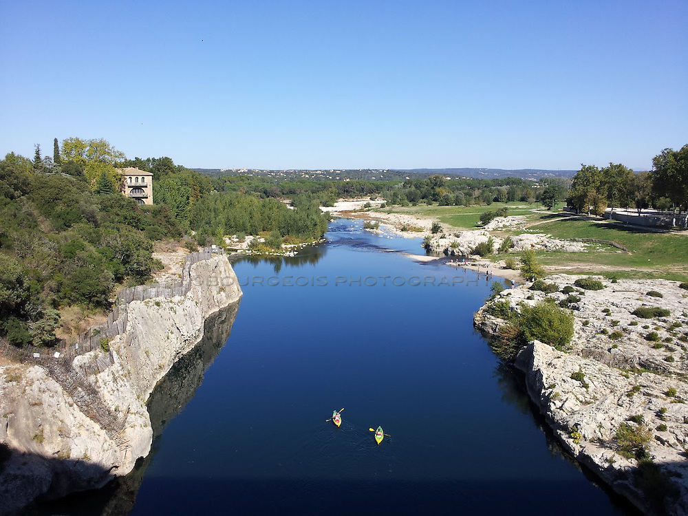 Two kayakers paddle down the Gard river in France