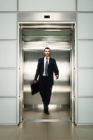 Businessman Exiting Elevator front view