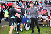 Salford City manager Graham Alexander and Port Vale manager John Askey shaking hands during the EFL Sky Bet League 2 match between Salford City and Port Vale at Moor Lane, Salford, United Kingdom on 17 August 2019.