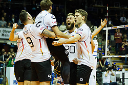 06.01.2016, Max Schmeling Halle, Berlin, GER, CEV Olympia Qualifikation, Deutschland vs Serbien, im Bild Gyorgy Georg Grozer (#9, Deutschland) hebt Patrick Steuerwald (#16, Deutschland, Germany) hoch, daneben Philipp Collin (#20, Deutschland, Germany) und Christian Duennes, Duennes (#10, Deutschland, Germany) // during the 2016 CEV Volleyball European Olympic Qualification Match between Germany and Serbia at the Max Schmeling Halle in Berlin, Germany on 2016/01/06. EXPA Pictures © 2016, PhotoCredit: EXPA/ Eibner-Pressefoto/ Wuechner<br /> <br /> *****ATTENTION - OUT of GER*****