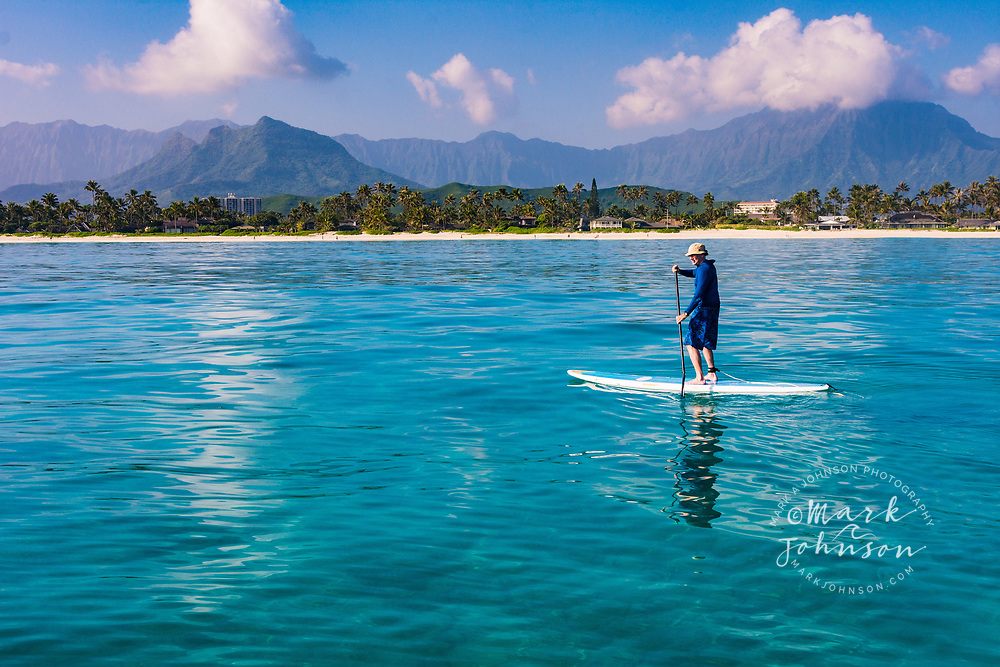 Stand-Up Paddle Boarder on a calm windless morning in Kailua Bay, Oahu, Hawaii
