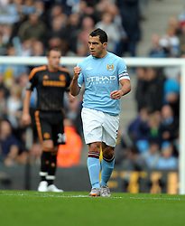 Carlos Tevez celebrates scoring during the Barclays Premier League match between Manchester City and Chelsea at the City of Manchester Stadium on September 25, 2010 in Manchester, England.