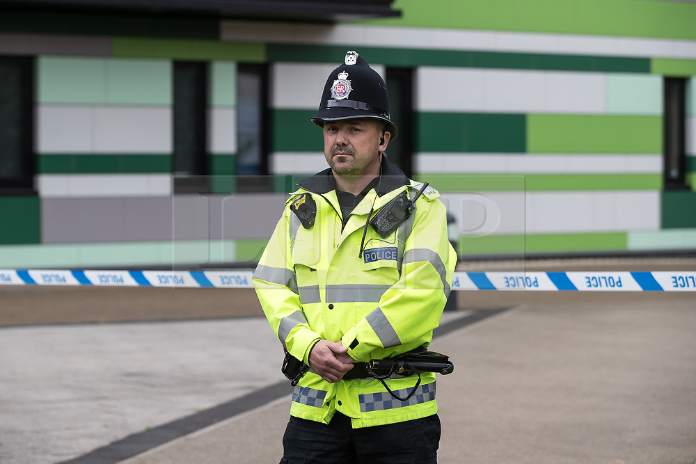 © Licensed to London News Pictures . 02/06/2017 . Manchester , UK . Police erect a 100m cordon around Banff Road after a car , which they say is significant in their investigation in to Salman Abedi , is discovered at Devell House , during a visit by the Duke of Cambridge , Prince William , at Royal Manchester Children's Hospital . The prince was meeting patients affected by the murderous bomb attack at an Ariana Grande gig at Manchester Arena on Monday 22nd May . Photo credit : Joel Goodman/LNP