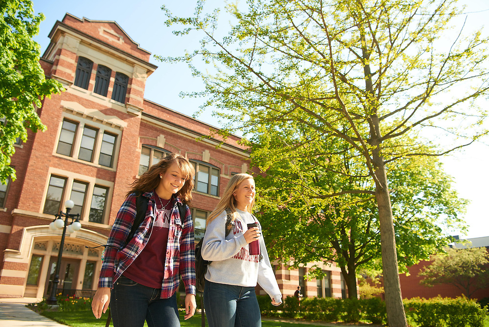 Activity; Walking; Smiling; Buildings; Graff Main Hall; Location; Outside; People; Woman Women; Student Students; Spring; May; Time/Weather; sunny; Type of Photography; Candid; Lifestyle; UWL UW-L UW-La Crosse University of Wisconsin-La Crosse; Emma Hermes