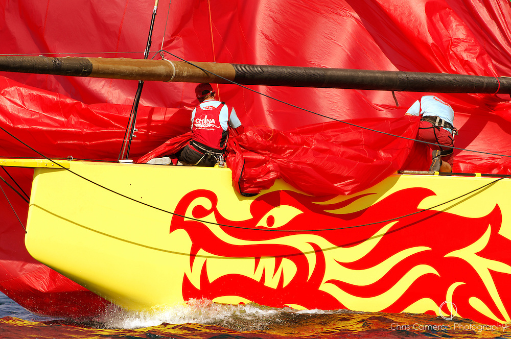 China Team CHN95 take down their spinnaker after their loss to Emirates Team New Zealand NZL92 in their round Robin two match of the Louis Vuitton Cup. 6/5/2007
