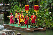 "A reenactment of the Hawaiian royal court in the Canoe Pageant, ""Rainbows of Paradise."" The Polynesian Cultural Center (PCC) is a major theme park and living museum, in Laie on the northeast coast (Windward Side) of the island of Oahu, Hawaii, USA. The PCC first opened in 1963 as a way for students at the adjacent Church College of Hawaii (now Brigham Young University Hawaii) to earn money for their education and as a means to preserve and portray the cultures of the people of Polynesia. Performers demonstrate Polynesian arts and crafts within simulated tropical villages, covering Hawaii, Aotearoa (New Zealand), Fiji, Samoa, Tahiti, Tonga and the Marquesas Islands. The Rapa Nui (Easter Island) exhibit features seven hand-carved moai (stone statues). The PCC is run by the Church of Jesus Christ of Latter-day Saints (LDS Church). For this photo's licensing options, please inquire."