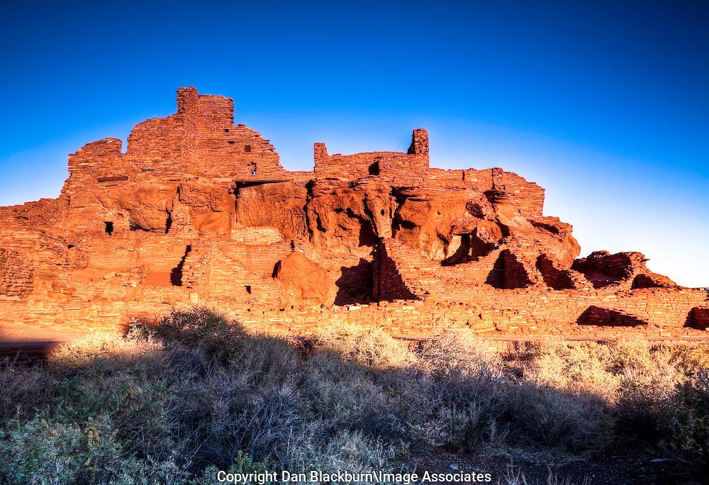 Sunrise Illuminates the Historic Wupatki Pueblo in Wupatki National Monument in Arizona