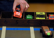26 FEB. 2011 -- ST. LOUIS -- Pinewood derby race cars are loaded into a starting box before the first race of the Adult Pinewood Derby sponsored by the Men's Club at Our Lady of Sorrows Catholic Church in St. Louis Saturday, Feb. 26, 2011. Proceeds from the event went to support Boy Scouts of America. Image copyright © 2011 Sid Hastings.