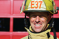 Portrait of smiling male firefighter in protective gear