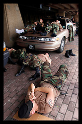31st August, 2005. 'Hell on earth.' The Superdome in New Orleans, Louisiana where over 20,000 refugees from hurricane Katrina are crammed into hellish conditions. Exhausted soldiers from the Louisiana National guard take a nap outside the Superdome.