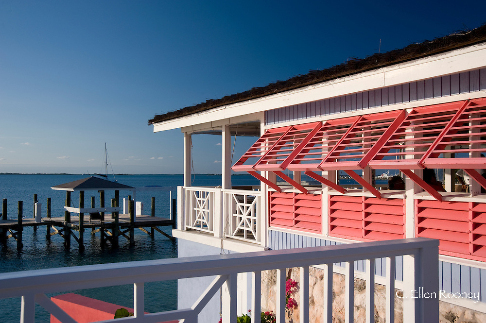 Brightly painted shutters at a bar and grill at the Ramora Bay Resort, Harbour Island, Eleuthera, The Bahamas