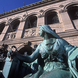 "Boston Public Library exterior, McKim, Mead & White Architects, in the Renaissance Revival style.Featuring statue of 'Art"" by Bela Pratt, 1912..Boston, MA"