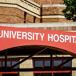 Photo of a University Hospital sign on the exterior of a hospital. Photo is high resolution and was taken in 2012.