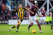 Dwayne Hislop (#8) of Auchinleck Talbot FC looks to tackle Uche Ikpeazu (#19) of Heart of Midlothian during the William Hill Scottish Cup match between Heart of Midlothian FC and Auchinleck Talbot FC at Tynecastle Stadium, Edinburgh, Scotland on 10 February 2019.
