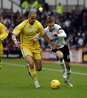 Photo: Kevin Poolman.<br />Derby County v Sheffield Wednesday. Coca Cola Championship. 13/01/2007. Madjid Boughera of Sheffield Wednesday and Arturo Lupoli (right) of Derby fight it out over the ball.
