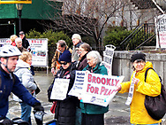 New York, NY. USA-March 27th, 2017- Vigil to Outlaw Nuclear Weapons at Isaiah Wall<br /> Today marks the first day of a week-long United Nations session to begin negotiations on a &ldquo;legally binding instrument to prohibit nuclear weapons, leading towards their total elimination.&rdquo; Last October, the First Committee of the UN General Assembly adopted the resolution for these talks 123 Yes, 38 No (including the U.S. and allies), and 16 Abstain.<br /> In response a number of anti-war and anti nuclear held a vigil and protest across from the United Nations were a meeting are taking place this week. Credit: Mark Apollo/Hashtag Occupy Media