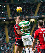 14th October 2017, Celtic Park, Glasgow, Scotland; Scottish Premiership football, Celtic versus Dundee; Celtic's Cristian Gamboa and Dundee's Jack Hendry clash heads
