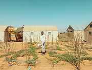 NIGER,, the refugee camp near the Agadez city. a little garden with few vegetables otuside a refugee tent. water is the main issue as it can be found only digging 300 meters underground. so everyday water comes with cisterns on tracks.