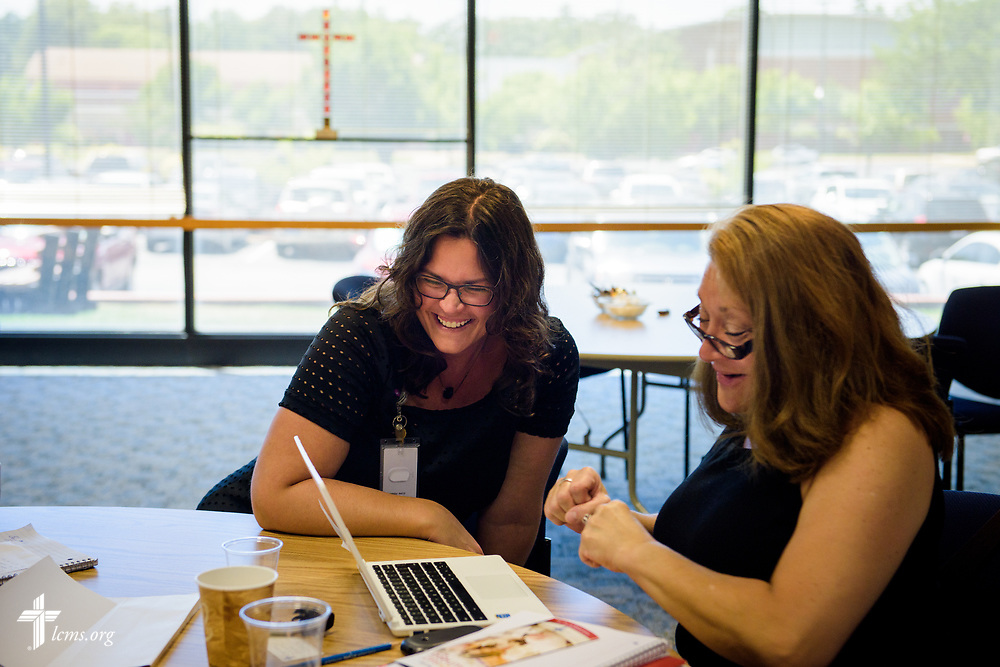 Erin Alter works with new missionary Deidre Christiansen during missionary orientation at the International Center of The Lutheran Church–Missouri Synod on Wednesday, July 12, 2017, in St. Louis.  LCMS Communications/Erik M. Lunsford
