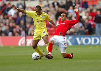 Photo: Leigh Quinnell.<br /> Nottingham Forest v Colchester United. Coca Cola League 1. 08/04/2006. Forests James Perch challenges Colchesters Neil Danns.