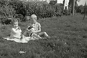Brother with younger sister and there dog