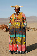 Traditional Herero woman in full traditional dress, Purros, Kaokoland. Northern Namibia..© Zute and Demelza Lightfoot.www.lightfootphoto.com