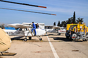 refueling a private airplane at an airstrip