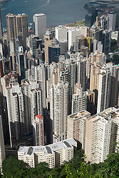 View of many high-rise apartment buildings in dense urban district of Hong Kong China