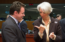 George Papaconstantinou, Greece's finance minister, left, speaks with Christine Lagarde, France's finance minister, during the meeting of European Union finance ministers in Brussels, Belgium, on Tuesday, May 18, 2010. (Photo © Jock Fistick)