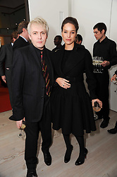 NICK RHODES and Marie-Louise Stoffel at a reception to launch the Saatchi Opus held at the Saatchi Gallery, King's Road, London on 26th November 2009.