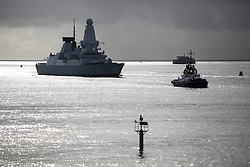 © Licensed to London News Pictures. 28/02/2014. Portsmouth, UK. The Royal Navy  Type 45 destroyer, HMS Daring arrives back in  her home port of Portsmouth today, 28th February 2014, following a 9 month trip. The trip included being diverted to help people in the Philippines following the devastation caused by Typhoon Haiyan. Photo credit : Rob Arnold/LNP