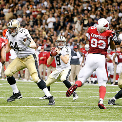 Sep 22, 2013; New Orleans, LA, USA; New Orleans Saints quarterback Drew Brees (9) is protected by tackle Zach Strief (64) and guard Tim Lelito (68) during a game against the Arizona Cardinals at Mercedes-Benz Superdome. The Saints defeated the Cardinals 31-7. Mandatory Credit: Derick E. Hingle-USA TODAY Sports