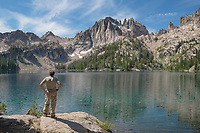 Adult male hiker enjoying the view of Baron Lake and Monte Verita Peak Sawtooth Mountains Idaho