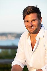 hot man at sunset smiling