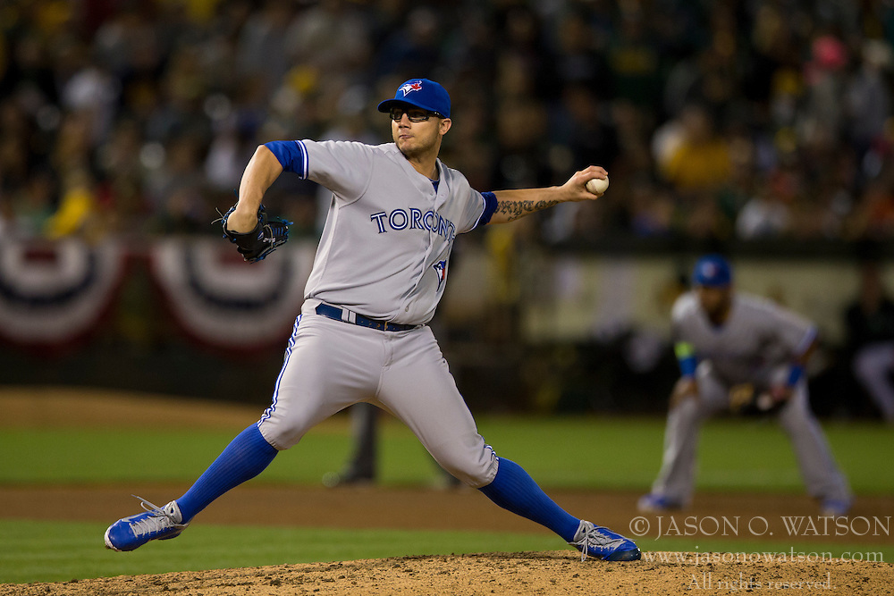 OAKLAND, CA - JULY 05:  Brett Cecil #27 of the Toronto Blue Jays pitches against the Oakland Athletics during the eighth inning at O.co Coliseum on July 5, 2014 in Oakland, California. The Oakland Athletics defeated the Toronto Blue Jays 5-1.  (Photo by Jason O. Watson/Getty Images) *** Local Caption *** Brett Cecil