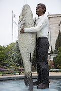 Man with Fish statue fountain outside the Shedd Aquarium in Chicago USA