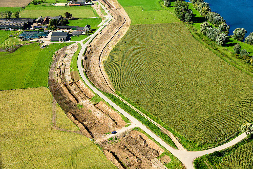 Nederland, Gelderland, Gemeente Buren, 26-06-2013; Rijswijk. Werkzaamheden aan de Rijnbandijk, het kader de  dijkversterking.<br /> Dike reinforcement winter dike lower-rhine.<br /> luchtfoto (toeslag op standaard tarieven);<br /> aerial photo (additional fee required); copyright foto/photo Siebe Swart.