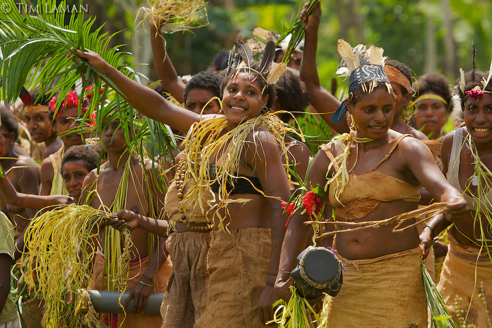 Villagers of Papasena dance to celebrate arrival of Bruce Beehler and team.
