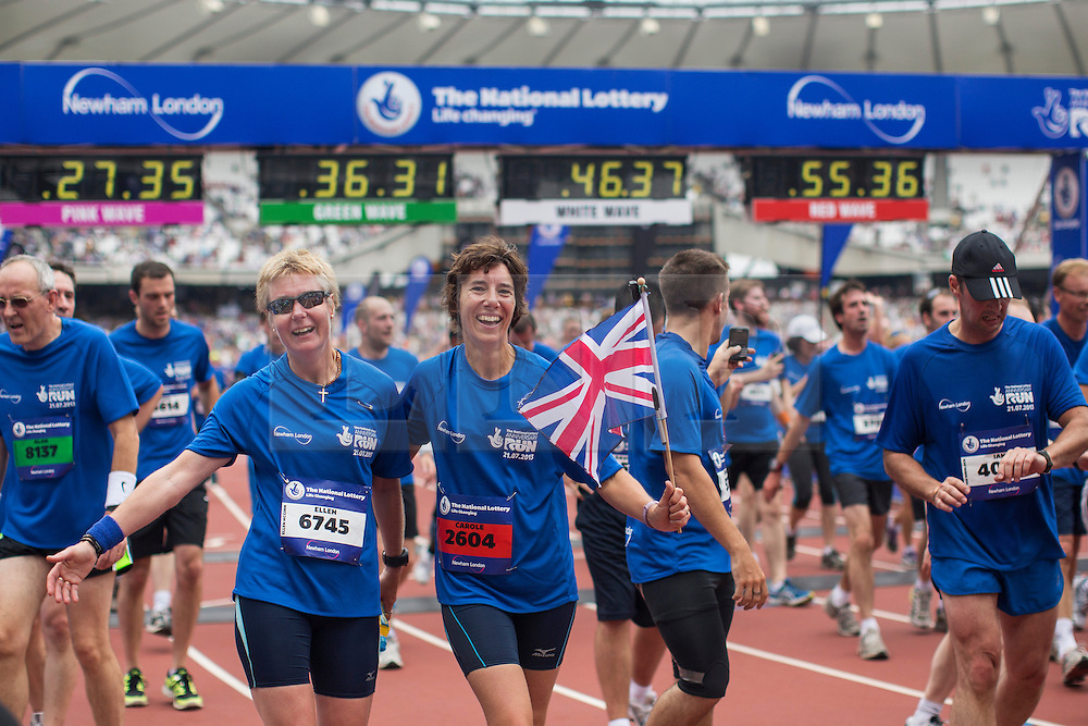 © licensed to London News Pictures. London, UK 21/07/2013. The Stadium at Queen Elizabeth Olympic Park open its doors to the public for the first time since London 2012 on Sunday, 21 July 2013 for The National Lottery Anniversary Run. Paula Radcliffe, Sir Chris Hoy and Victoria Pendleton also took part at the event to support 12,500 runners. Photo credit: Tolga Akmen/LNP