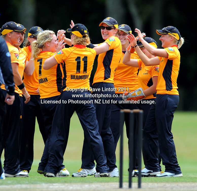 Blaze players celebrate the dismissal of Janet Brehaut, which gave bowler Lucy Doolan a hattrick of three consecutive wickets. Women's Twenty20 cricket - Wellington Blaze v Canterbury Magicians at Barton Oval, Upper Hutt, Wellington on Tuesday, 4 January 2011. Photo: Dave Lintott / photosport.co.nz