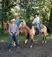 Jordan Staton, left, Kassie Kautzman, and Arianna Alvarez will be competing in the national rodeo finals in Wyoming next week. The trio is seen here on Wednesday, July 9, 2014, at their practice arena outside of Kindred, N.D.<br /> Nick Wagner / The Forum