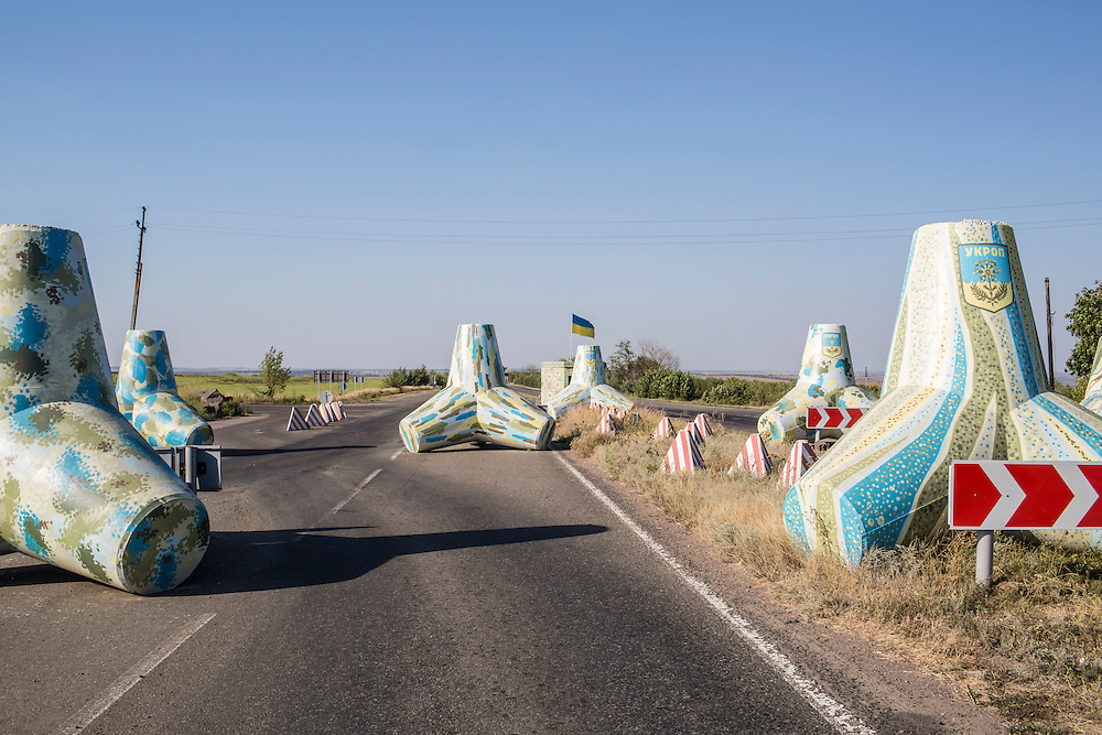 KALCHYK, UKRAINE - AUGUST 29, 2015: Colorfully painted tank traps at an empty Ukrainian checkpoint on the main road between Mariupol and Donetsk near Kalchyk, Ukraine. CREDIT: Brendan Hoffman for The New York Times